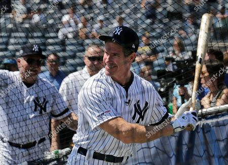 Former New York Yankee Paul O'Neill take batting practice during Old Timer's Day at Yankee Stadium, in New York