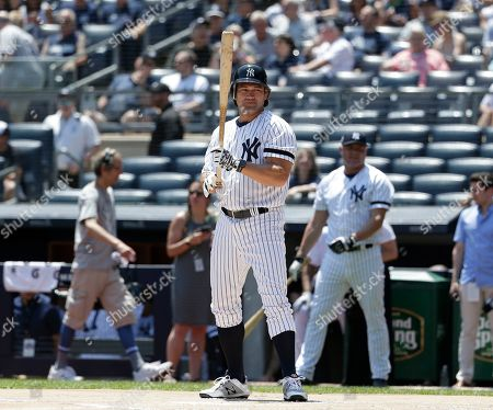 Former New York Yankee Johnny Damon prepares to bat during Old Timer's Day at Yankee Stadium, in New York