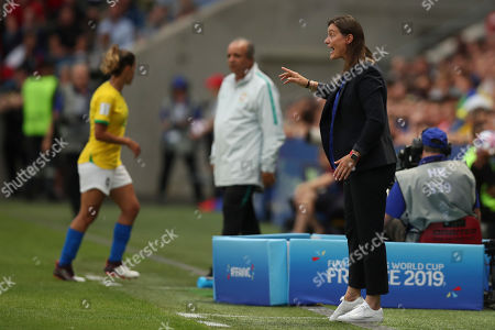 France coach Corinne Diacre gives directions to the players during the Women's World Cup round of 16 soccer match between France and Brazil at the Oceane stadium in Le Havre, France