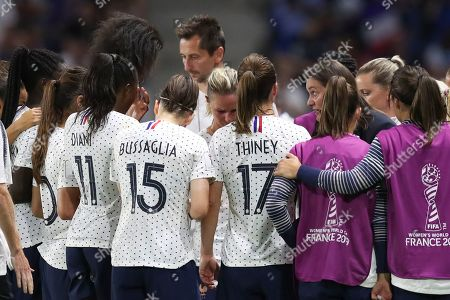 France coach Corinne Diacre, right, talks with her players during the Women's World Cup round of 16 soccer match between France and Brazil at the Oceane stadium in Le Havre, France