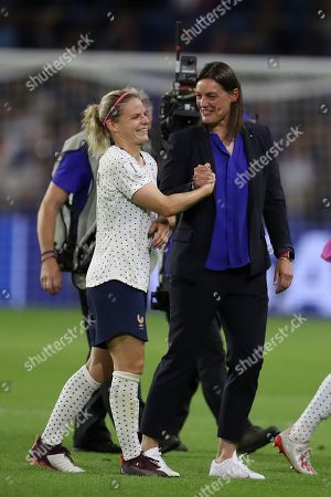 France coach Corinne Diacre, right, celebrates with players at the end of the Women's World Cup round of 16 soccer match between France and Brazil at the Oceane stadium in Le Havre, France, . France beat Brazil 2-1