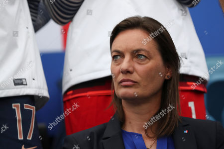 France coach Corinne Diacre looks at the pitch before the start of the Women's World Cup round of 16 soccer match between France and Brazil at the Oceane stadium in Le Havre, France