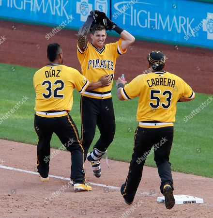 Kevin Newman, Elias Diaz, Melky Cabrera. Pittsburgh Pirates' Kevin Newman, center, celebrates with Elias Diaz (32) and Melky Cabrera (53) after drawing a walk from San Diego Padres relief pitcher Matt Wisler with bases loaded, forcing in the walk-off game-winning run during the 11th inning of a baseball game in Pittsburgh, . The Pirates won in 11-innings, 11-10