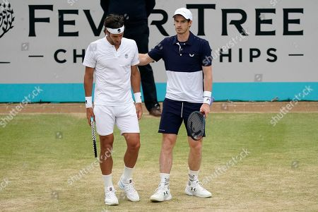 Britain's Andy Murray (R) with Feliciano Lopez of Spain (L) during their mens doubles final match against Britain's Joe Salisbury and Rajeev Ram at the Fever Tree Championship at Queen's Club in London, Britain, 23 June 2019. The tournament runs from 17th June till 23 June 2019.