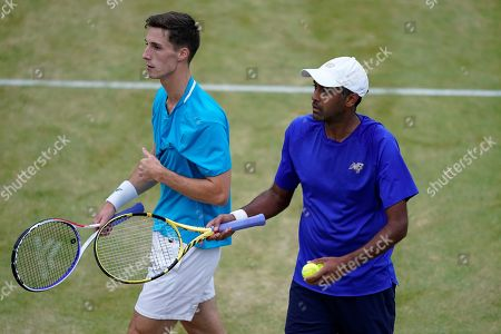 Britain's Joe Salisbury (L) and USA's Rajeev Ram (R) during their mens doubles final match against Britain's  Andy Murray and Spain's Feliciano Lopez at the Fever Tree Championship at Queen's Club in London, Britain, 23 June 2019. The tournament runs from 17th June till 23 June 2019.
