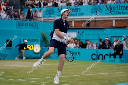 Britain's Andy Murray celebrates after winning his mens doubles final match with Feliciano Lopez of Spain against Britain's Joe Salisbury and Rajeev Ram at the Fever Tree Championship at Queen's Club in London, Britain, 23 June 2019.