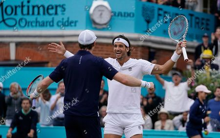 Britain's Andy Murray (L) celebrates with Feliciano Lopez of Spain (R) after winning their mens doubles final match against Britain's Joe Salisbury and Rajeev Ram at the Fever Tree Championship at Queen's Club in London, Britain, 23 June 2019.