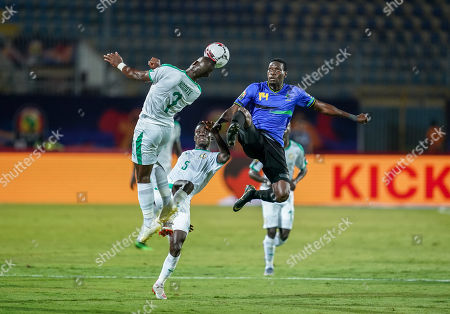 Moussa Konate of Senegal and John Raphael Bocco of Tanzania during the African Cup of Nations match between Senegal and Tanzania at the 30 November Stadium in Cairo, Egypt