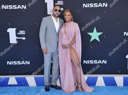 Michael Sterling, Eva Marcille. Michael Sterling, left, and Eva Marcille arrive at the BET Awards, at the Microsoft Theater in Los Angeles