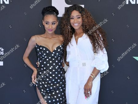 Tami Roman, Lyric Anderson. Tami Roman, right, and Lyric Anderson arrive at the BET Awards, at the Microsoft Theater in Los Angeles