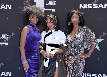 Riele Downs, Riele Downs, Elle Downs. Sisters Riele Downs, from left, Riele Downs and their mother Elle Downs arrive at the BET Awards, at the Microsoft Theater in Los Angeles