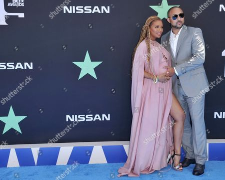 Michael Sterling, Eva Marcille. Eva Marcille, left, and Michael Sterling arrive at the BET Awards, at the Microsoft Theater in Los Angeles