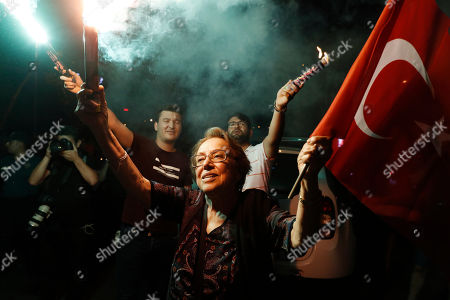 Supporters of Ekrem Imamoglu, the candidate of the secular opposition Republican People's Party, CHP, light up a flare as they celebrate in central Istanbul, . In a blow to Turkish President Recep Tayyip Erdogan, Imamoglu declared victory in the Istanbul mayor's race for a second time Sunday after Binali Yildirim, the government-backed candidate conceded defeat in a high-stakes repeat election