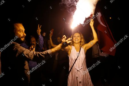 Stock Picture of Supporters of Ekrem Imamoglu, the candidate of the secular opposition Republican People's Party, CHP, light up a flare as they celebrate in Istanbul, . Imamoglu declared victory in the Istanbul mayor's race for a second time Sunday after Binali Yildirim, the government-backed candidate conceded defeat in a high-stakes repeat election