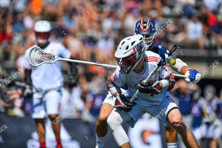 Chaos' Connor Fields battles Archers' Jackson Place during a Premier Lacrosse League game on in Baltimore
