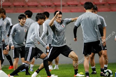 Japan's national soccer team player Naomichi Ueda (C) participates in a training session at the Mineirao stadium, in Belo Horizonte, Brazil, 23 June 2019.