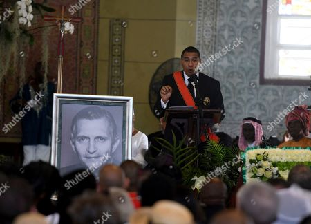 Jamaica's Prime Minister Andrew Holness speaks during the funeral service for former Jamaican Prime Minister Edward Seaga inside the Most Holy Trinity Cathedral in Kingston, Jamaica, . Seaga served as prime minister from 1980 until 1989 and was the only remaining member of the generation of leaders who drafted the constitution when the island gained independence from Britain in 1962. He died in Florida on May 28 on his 89th birthday
