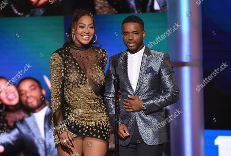 Larenz Tate, Lala Anthony. Lala Anthony, left, and Larenz Tate present the award for best movie at the BET Awards, at the Microsoft Theater in Los Angeles