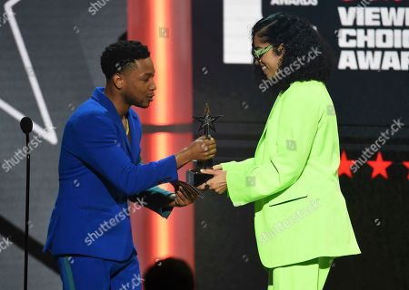 """Jacob Latimore, Ella Mai. Jacob Latimore, left, presents Ella Mai with the viewers' choice award for """"Trip"""" at the BET Awards, at the Microsoft Theater in Los Angeles"""