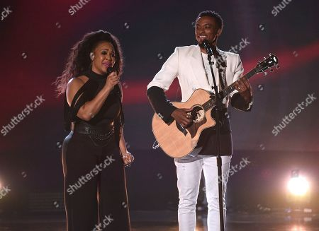 Stock Image of Erica Atkins, Jonathan McReynolds. Erica Atkins, left, and Jonathan McReynolds perform at the BET Awards, at the Microsoft Theater in Los Angeles