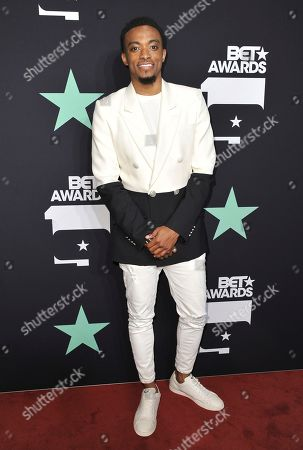 Jonathan McReynolds poses in the press room at the BET Awards, at the Microsoft Theater in Los Angeles