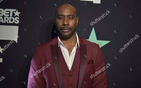 Morris Chestnut poses in the press room at the BET Awards, at the Microsoft Theater in Los Angeles