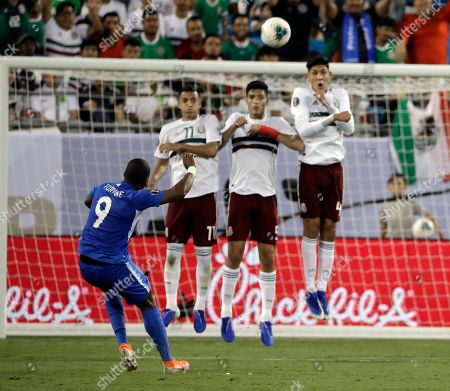 Kevin Fortune, Roberto Alvarado, Diego Reyes, Edson Alvarez. Martinique's Kevin Fortune (9) takes a free kick over Mexico players Roberto Alvarado (11), Diego Reyes (5) and Edson Alvarez (4) during the first half of a CONCACAF Golf Cup soccer match in Charlotte, N.C