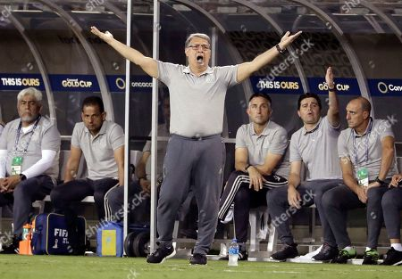 Mexico head coach Gerardo Martino reacts during the first half of a CONCACAF Golf Cup soccer match against Martinique in Charlotte, N.C