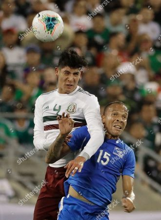 Stock Picture of Audrick Linord, Edson Alvarez. Martinique's Audrick Linord (15) is fouled by Mexico's Edson Alvarez (4) during the first half of their CONCACAF Golf Cup soccer match in Charlotte, N.C