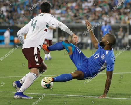 Kevin Parsemain, Edson Alvarez. Martinique's Kevin Parsemain (17) falls after being fouled by Mexico's Edson Alvarez (4) during the second half of their CONCACAF Golf Cup soccer match in Charlotte, N.C