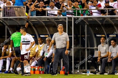 Mexico Head Coach Gerardo Martino draws a yellow card late in the Gold Cup match at Bank of America Stadium in Charlotte, NC. (Scott Kinser)