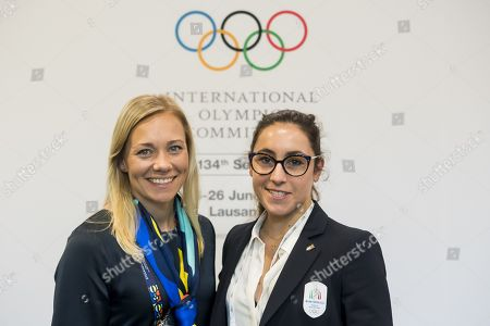 Frida Hansdotter, a former ski racer from Sweden (L) and Italian skier Sofia Goggia (R) pose for photos during on the first day of the 134th Session of the International Olympic Committee (IOC) at the SwissTech Convention Centre in Lausanne, Switzerland, Monday, June 24, 2019. The host city of the 2026 Olympic Winter Games will be decided during the134th IOC Session. Stockholm-Are in Sweden and Milan-Cortina in Italy are the two candidate cities for the Olympic Winter Games 2026.