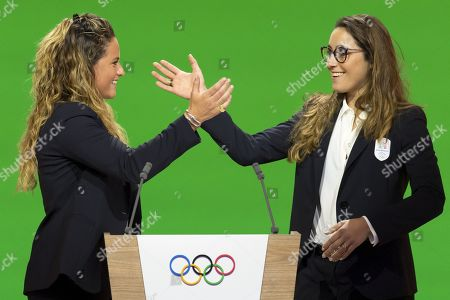 Italian snowboarder Michela Moioli (L) and Italian skier Sofia Goggia,  during the presentation final presentation of the Milan-Cortina candidate cities the first day of the 134th Se ssion of the International Olympic Committee (IOC), at the SwissTech Convention Centre, in Lausanne, Switzerland, Monday, June 24, 2019.  The host city of the 2026 Olympic Winter Games will be decided during the134th IOC Session. Stockholm-Are in Sweden and Milan-Cortina in Italy are the two candidate cities for the Olympic Winter Games 2026.