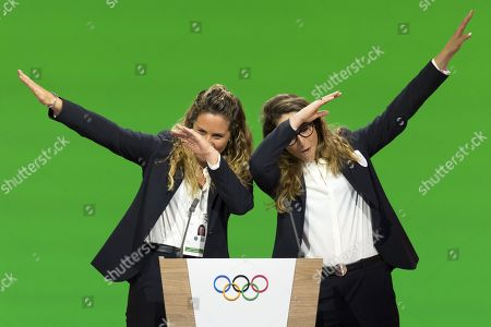 Italian snowboarder Michela Moioli (L) and Italian skier Sofia Goggia, dab after speaking during the presentation final presentation of the Milan-Cortina candidate cities the first day of the 134th Se ssion of the International Olympic Committee (IOC), at the SwissTech Convention Centre, in Lausanne, Switzerland, Monday, June 24, 2019.  The host city of the 2026 Olympic Winter Games will be decided during the134th IOC Session. Stockholm-Are in Sweden and Milan-Cortina in Italy are the two candidate cities for the Olympic Winter Games 2026.