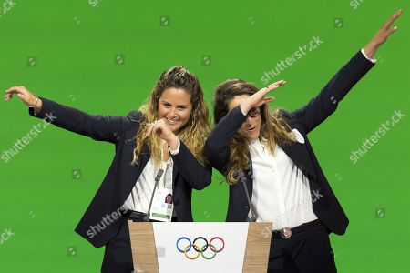 Italian snowboarder Michela Moioli (L) and Italian skier Sofia Goggia (R) dab after speaking during the final presentation of the Milan-Cortina candidate cities the first day of the 134th Session of the International Olympic Committee (IOC), at the SwissTech Convention Centre, in Lausanne, Switzerland,  24 June 2019. The host city of the 2026 Olympic Winter Games will be decided during the134th IOC Session. Stockholm-Are in Sweden and Milan-Cortina in Italy are the two candidate cities for the Olympic Winter Games 2026.