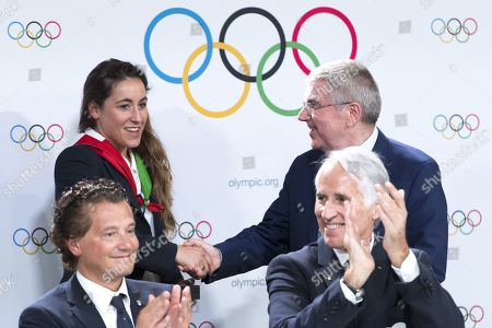 Italian skier Sofia Goggia (L) is congratuled by International Olympic Committee (IOC) president Thomas Bach (R) from Germany behind Mayor of Cortina Gianpietro Ghedina (2-L) and Italy's National Olympic Committee (CONI) president Giovanni Malago (2-R) after Milan-Cortina in Italy has won the bid to host the 2026 Winter Olympic Games the first day of the 134th Session of the International Olympic Committee (IOC), at the SwissTech Convention Centre, in Lausanne, Switzerland, 24 June 2019.