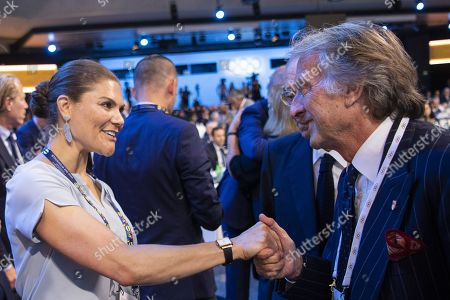 Stock Image of Sweden's Crown Princess Victoria (L), member of the candidate for the Olympic Winter Games 2026 Stockholm-Are delegation shakes hands with Luca Cordero di Montezemolo (R) , member of the Milan-Cortina delegation, after International Olympic Committee (IOC) president Thomas Bach from Germany announced that Milan-Cortina has won the bid to host the 2026 Winter Olympic Games during the first day of the 134th Session of the International Olympic Committee (IOC), at the SwissTech Convention Centre, in Lausanne, Switzerland, 24 June 2019.