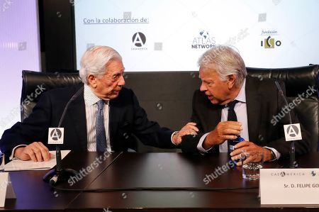 Spanish former Prime Minister Felipe Gonzalez (R) and Peruvian writer Mario Vargas Llosa (L) take part in the debate 'A dialogue about the challenges of Spain and Latin America' within the 12th edition of the Atlantic Forum held in Madrid, Spain, 24 June 2019.