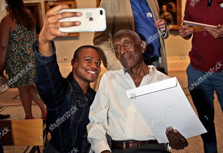 Justin Sams, George Stewart. Justin Sams, left, takes a picture with George Stewart during a Stonewall 50 time-capsule event at the New-York Historical Society in New York, . Sams shared his message in the Generations Project, a project committed to preserving LGBTQ history and will next be read again in 2069