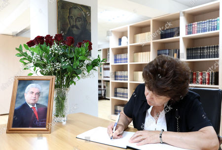 A woman signs the condolence book for late former Cyprus President Demetris Christofias in Nicosia, Cyprus, 24 June 2019. Christofias died 21 June and his funeral will take place on 25 June. Demetris Christofias was the sixth President of the Republic of Cyprus. He was elected President on 24 February 2008, and performed his duties until 28 February 2013.