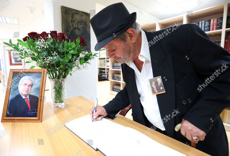 A man signs the condolence book for late former Cyprus President Demetris Christofias in Nicosia, Cyprus, 24 June 2019. Christofias died 21 June and his funeral will take place on 25 June. Demetris Christofias was the sixth President of the Republic of Cyprus. He was elected President on 24 February 2008, and performed his duties until 28 February 2013.