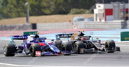 Kevin Magnussen, Rich Energy Haas F1 Team and Alexander Albon, Red Bull Toro Rosso Honda