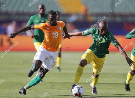 South Africa's Percy Tau, left, and Ivory Coast's Wilfried Bony fight for the ball during the African Cup of Nations group D soccer match between Ivory Coast and South Africa in Al Salam Stadium in Cairo, Egypt