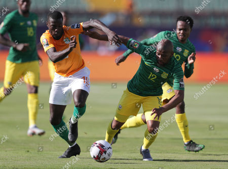 Stock Photo of South Africa's Percy Tau, left, and Ivory Coast's Wilfried Bony fight for the ball during the African Cup of Nations group D soccer match between Ivory Coast and South Africa in Al Salam Stadium in Cairo, Egypt