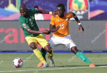 Ivory Coast's Serge Wilfried Kanon, left, and South Africa's Dean Furman fight for the ball during the African Cup of Nations group D soccer match between Ivory Coast and South Africa in Al Salam Stadium in Cairo, Egypt