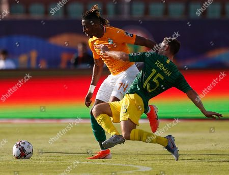 South Africa's Dean Furman tries to stop Ivory Coast's Jonathan Kodjia during the African Cup of Nations group D soccer match between Ivory Coast and South Africa in Al Salam Stadium in Cairo, Egypt
