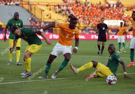 South Africa player Thamsqa Innocent (R)  and Dean Fuurman (L) in action aganist  Ivory Coast's player Wilfried Zaha during the 2019 Africa Cup of Nations (AFCON) Group D soccer match between Ivory Coast and South Africa at the Al Salaam Stadium, Cairo, Egypt, 24 June 2019.