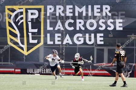 Chrome's Jordan Wolf tries to get past the long stick of Archers' Matt McMahon during a Premiere Lacrosse League game on in Foxborough, Mass