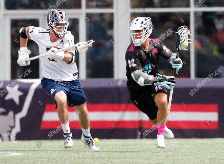 Chrome's Jordan Wolf tries to get past Archers' Matt McMahon during a Premiere Lacrosse League game on in Foxborough, Mass