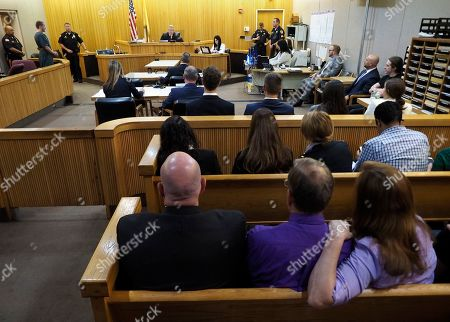 Michael Stern the victims father, seated foreground second from right, wearing purple (his daughters favorite color) listens as Liam McAtasney, standing background second from left, is sentenced to life without parole for the murder of Sarah Stern. McAtasney appeared in Monmouth County Superior Court before Judge Richard W. English